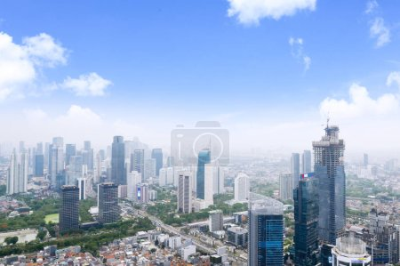 Photo for JAKARTA, Indonesia - January 15, 2020: Aerial view of UOB Plaza and other skyscrapers along with building constructions in Jakarta city - Royalty Free Image