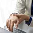 Постер, плакат: Office syndrome hand pain by occupational disease Closeup business woman with wrist pain Woman holding her wrist pain from using computer