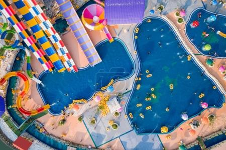 PHITSANULOK, THAILAND - APRIL 8 : The unidentified people in Splash Fun water park in Phitsanulok on April 8, 2017. Aerial view from flying drone