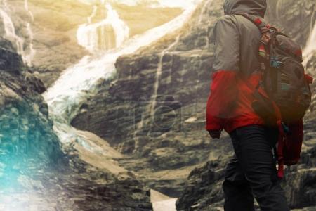 Traveler near a glacier