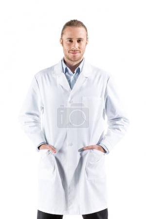 Photo for Young doctor in white coat looking at camera isolated on white - Royalty Free Image