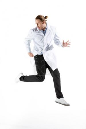 Doctor in white coat jumping