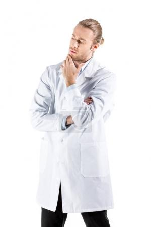Photo for Pensive young doctor in white coat isolated on white - Royalty Free Image