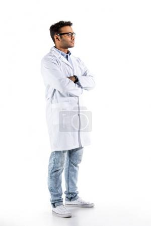 Photo for Young doctor in white coat gesturing and looking at camera isolated on white - Royalty Free Image