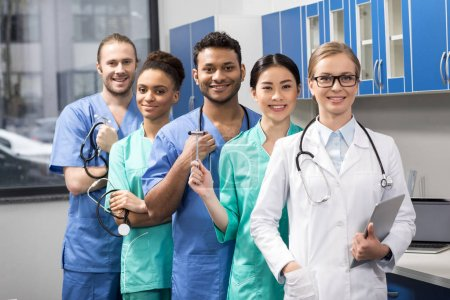 Photo for Group of smiling medical workers with equipment in laboratory - Royalty Free Image