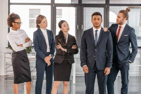 Photo for Young businesspeople in formalwear posing while standing at modern office, multicultural business team - Royalty Free Image