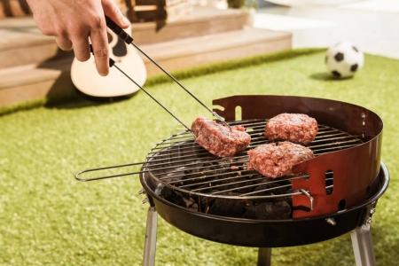 Person grilling burgers