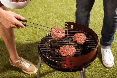 People grilling burgers