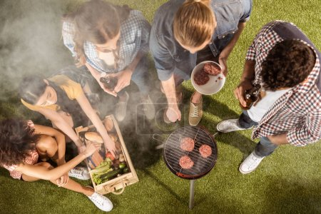 Friends making barbecue
