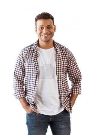 Photo for Portrait of handsome young man with hands in pockets smiling at camera - Royalty Free Image