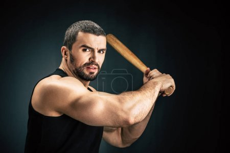 sportive man with baseball bat