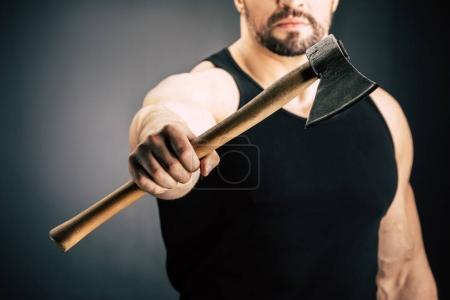 sportive man holding axe
