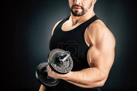 Sportive man pumping muscles
