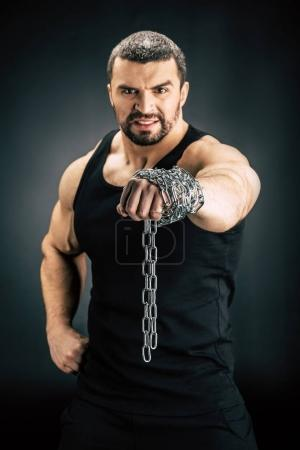 man with metal chain