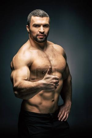 athletic man showing thumb up