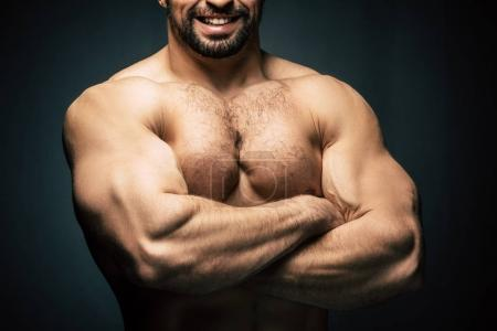 shirtless sportive man showing muscles