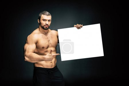 athletic man with blank banner