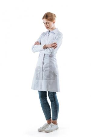 Photo for Upset female chemist in white coat with crossed arms, isolated on white - Royalty Free Image