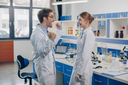 excited scientists in laboratory