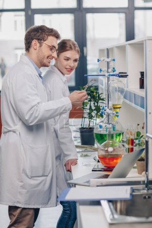 biologists working in laboratory
