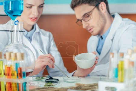 biologists with petri dishes