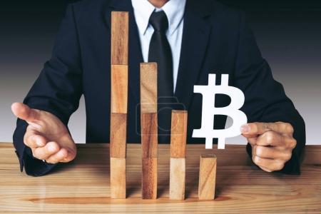 Business Economic crisis concept, Businessman holding showing bi