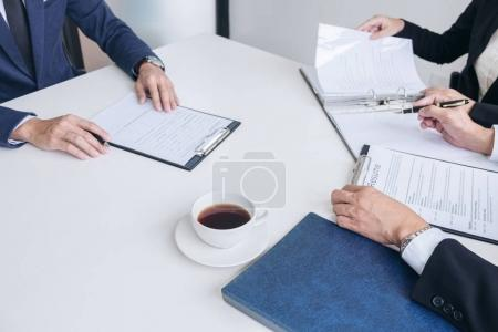 Photo for Interviewer or Board reading a resume during a job interview, Employer interviewing a young male job seeker for recruitment talking in modern office, employment and recruitment concept. - Royalty Free Image