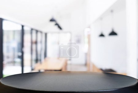 Photo for Empty wooden table and blurred background of abstract in front of restaurant or coffee shop for display of product or for montage. - Royalty Free Image