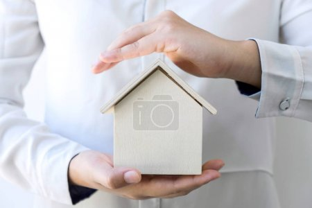 insurance and care protection of house concept, woman with prote
