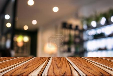 Empty wooden table and blurred background of abstract in front o