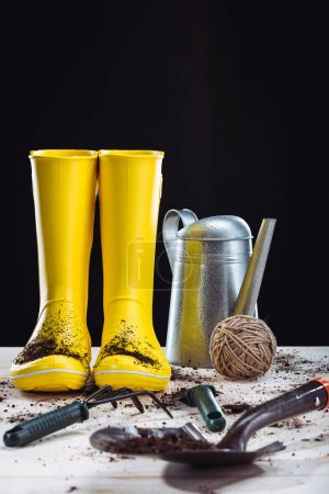Rubber boots and garden tools