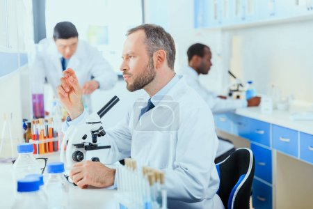 Photo for Young doctors in uniform working at testing laboratory, laboratory technicians - Royalty Free Image