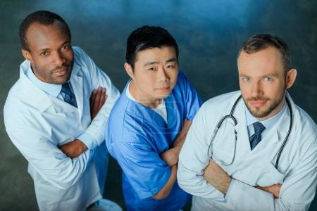 Photo for High angle view of multiracial group of doctors standing in row in clinic - Royalty Free Image