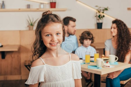 cheerful little girl in cafe