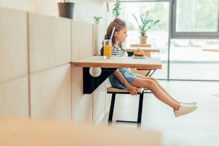 cute little girl  in cafe