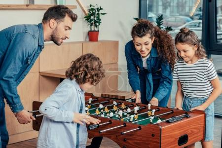 family playing table football