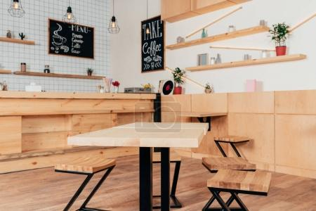 Photo for Stylish interior of modern cafe with stylish wooden furniture - Royalty Free Image