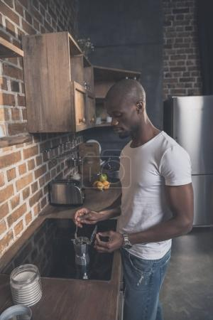 African american man preparing coffee