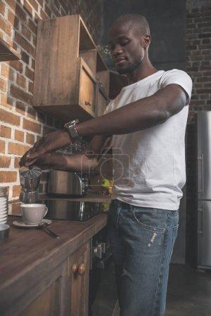 African american man preparing coffee