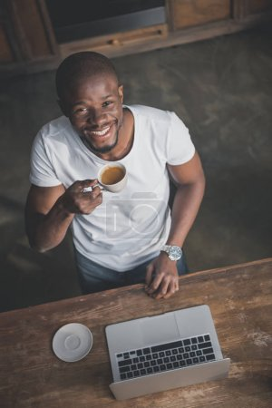 African american with coffee and laptop