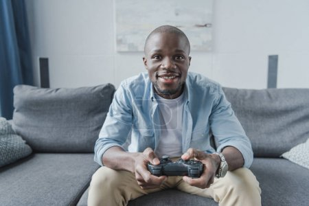 African american man playing with joystick