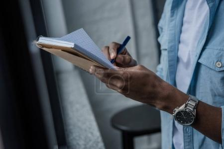 african american man writing notes