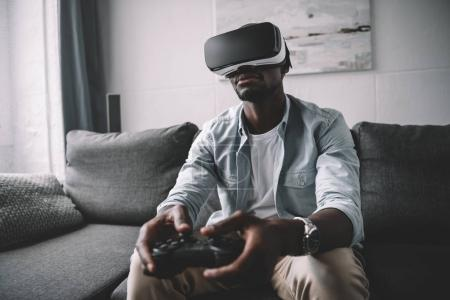African american man using virtual reality headset