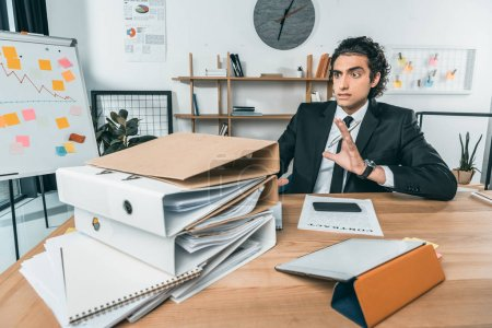 businessman doing paperwork in office