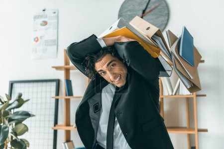 businessman and falling folders in office