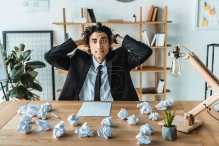 overworked businessman at workplace