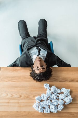 Businessman lying on table