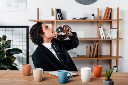 businessman drinking coffee from coffee pot