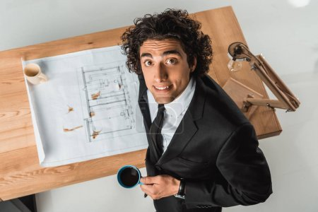 businessman working with blueprints