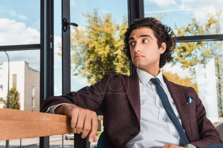 businessman sitting at table in office